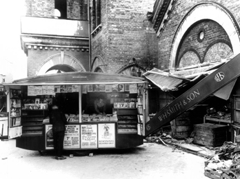 A travelling bookstall outside a severely damaged WHSmith shop